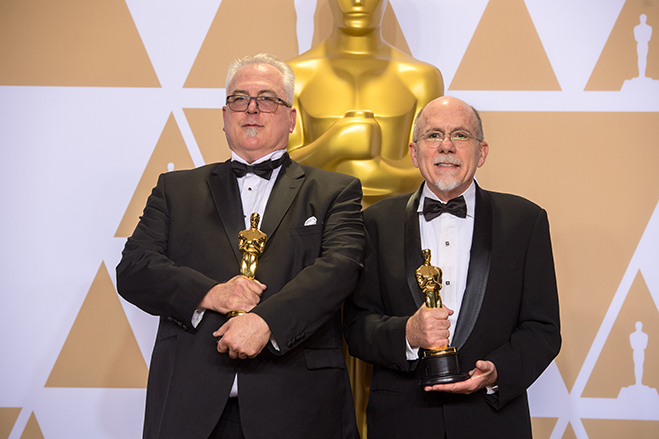 Alex Gibson and Richard King pose backstage with the Oscar for achievement in Sound Editing. Photo credit: Michael Baker / A.M.P.A.S.
