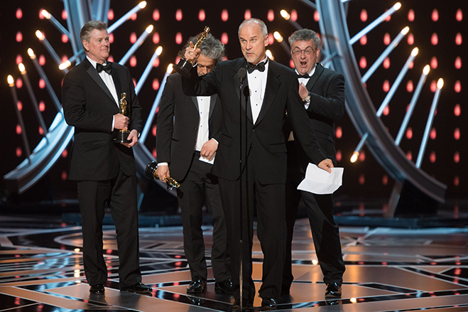 Richard R. Hoover, Gerd Nefzer, Paul Lambert and John Nelson accept the Oscar for Achievement in Visual Effects. Photo credit: Aaron Poole / A.M.P.A.S.